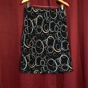 Flowy black skirt with circle design. Sz L.